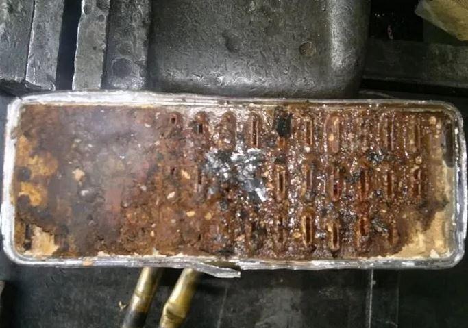 Забитый печной радиатор. Почему не греет печка?